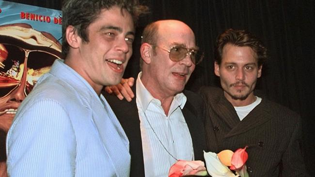 The actor was close friends with  <i>Fear and Loathing in Las Vegas</i> author Hunter S. Thompson (centre). Credit: AP Photo/Kathy Willens.