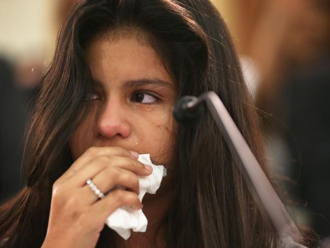 Needing help ... Mayeli Hernandez, 12, wipes tears as she tells her story of escaping her home country of Honduras at a hearing before the Congressional Progressive Caucus in Washington, DC. Picture: Alex Wong