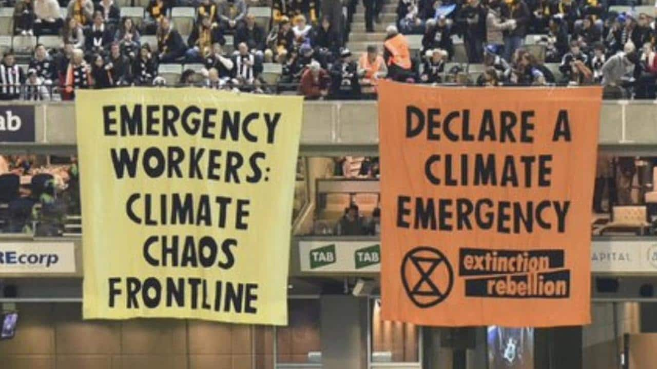 Climate change banners hang from the Ponsford Stand.
