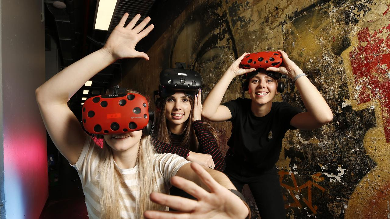 Bec Stewart, Lux Warner and Ellen Skinner at the Australian Virtual Reality Film Festival at Brisbane Powerhouse. Picture: AAP