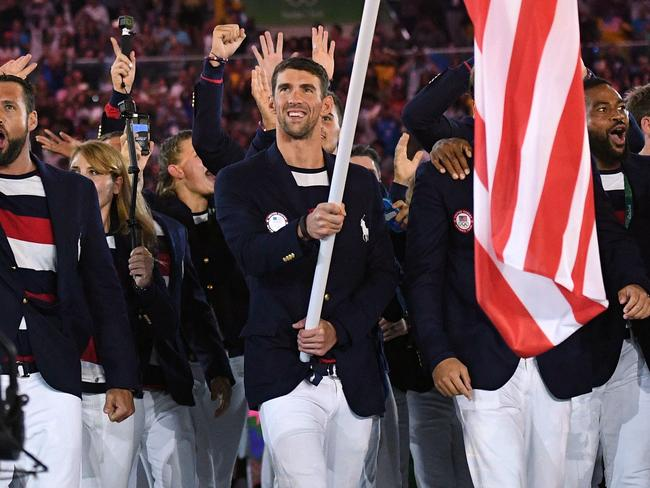 The USA's Michael Phelps carries the flag during the opening ceremony of Rio 2016.