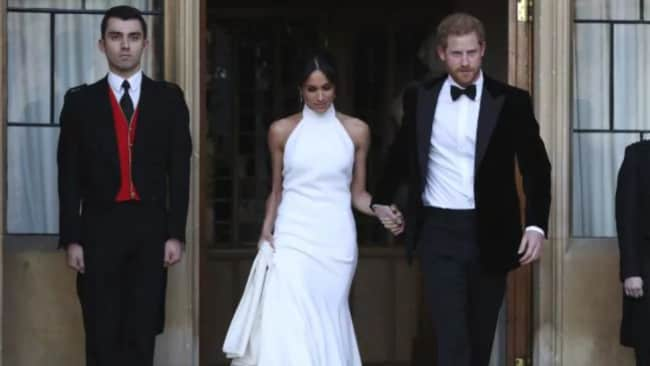 Meghan had changed into a Stella McCartney dress for the intimate party of 200, while Prince Harry wore a tuxedo. Picture: AP Source:AP