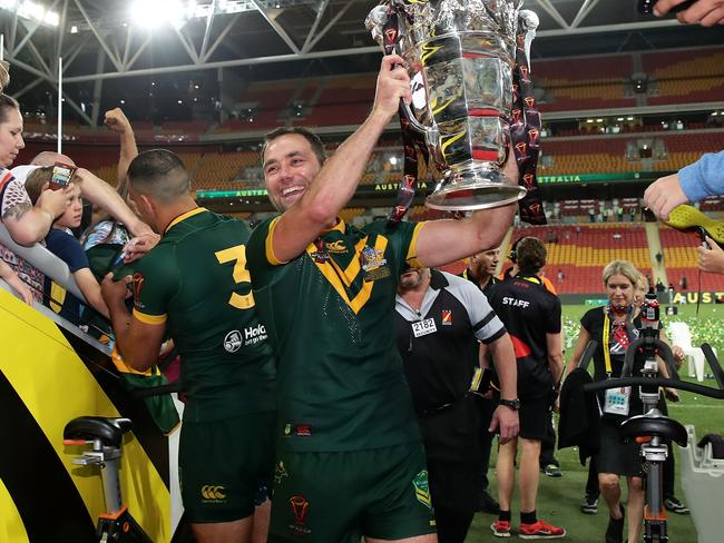 Cameron Smith of the Kangaroos holds aloft the Rugby League World Cup.