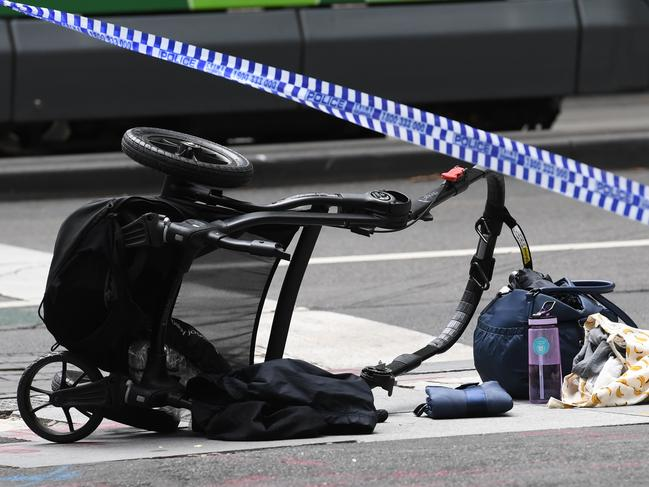The overturned pram on the corner of Bourke and William streets after James Gargasoulas drove through, killing six people. Picture: Julian Smith/AAP