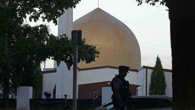 A police officer stands guard in front of the Al Noor mosque in Christchurch, New Zealand. Picture: AP