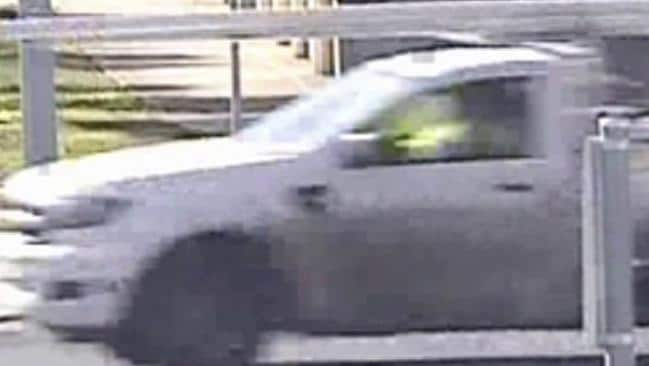 A white Ford ranger singe-cab ute, towing a dual-axle trailer with a yellow mini-excavator on it, was seen around the time the black Mercedes was captured on CCTV. Picture: Victoria Police