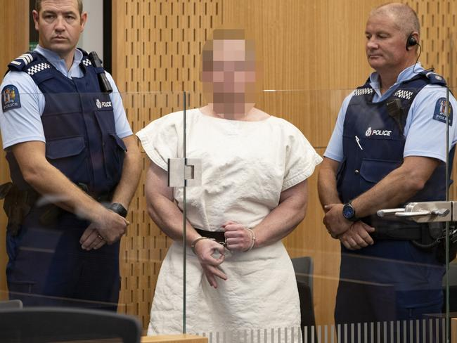 Brenton Tarrant making a sign to the camera during his appearance, for murder, in the Christchurch District Court. Picture: Mark Mitchell/NZ Herald