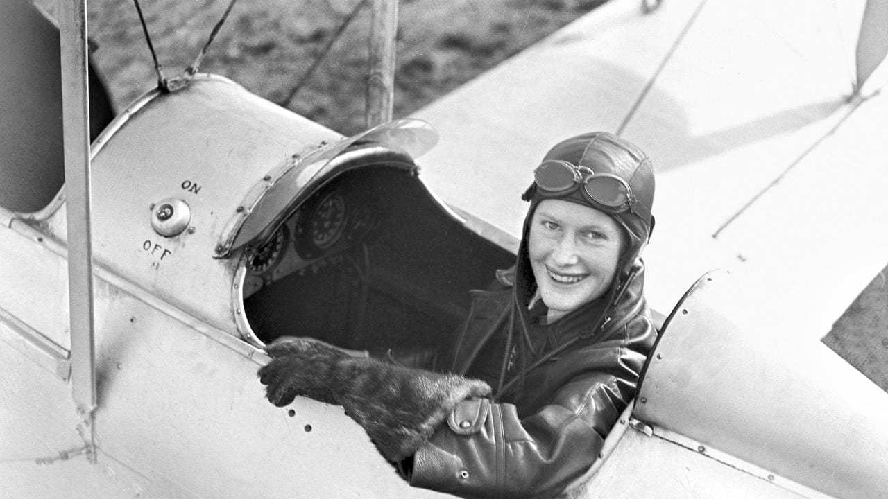 An early photo of Nancy-Bird Walton. You can see the plane has an open cabin and wires attaching the wings to the body and she wore goggles and warm gloves to protect her from the wind and cold. Picture: supplied