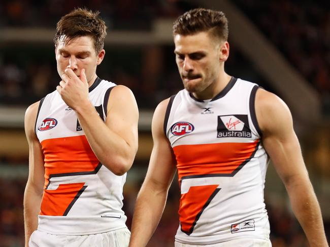 Toby Greene (left) and Stephen Coniglio. (Photo by Michael Willson/AFL Media/Getty Images)