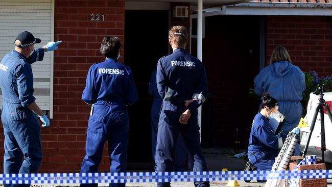 Forensic officers examine the scene. Picture: Nicole Garmston