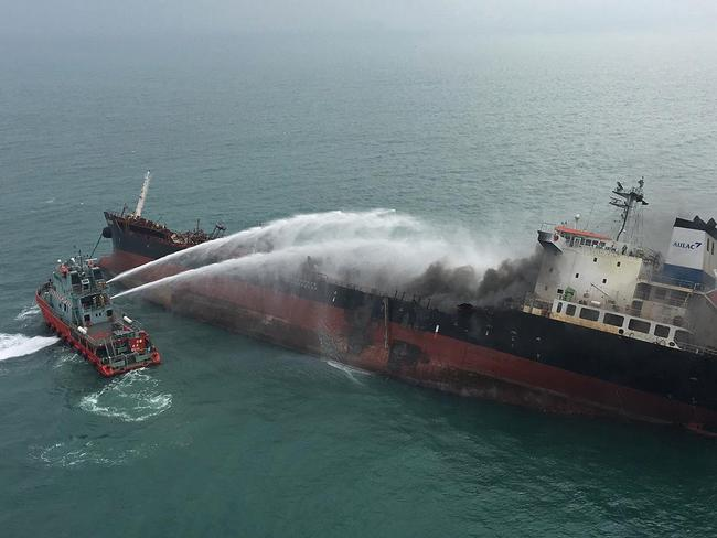A Vietnam-registered oil tanker burst into flames as it prepared to refuel at an anchorage off Hong Kong's southern coast. Picture: Hong Kong Government Flying Service/AP