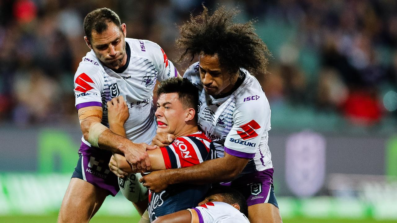 Cameron Smith and Felise Kaufusi wrap up Joseph Manu.