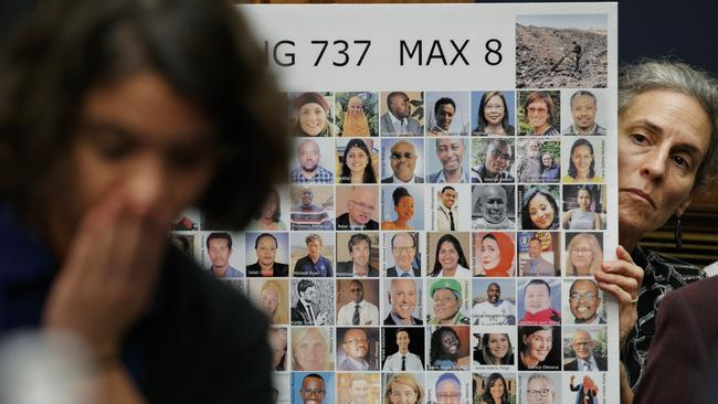 Protesters including Nadia Milleron, the mother of Samya Rose Stumo, arrive at a House Transportation and Infrastructure Committee hearing with photos of crash victims. Picture: Jacquelyn Martin/AP Photo
