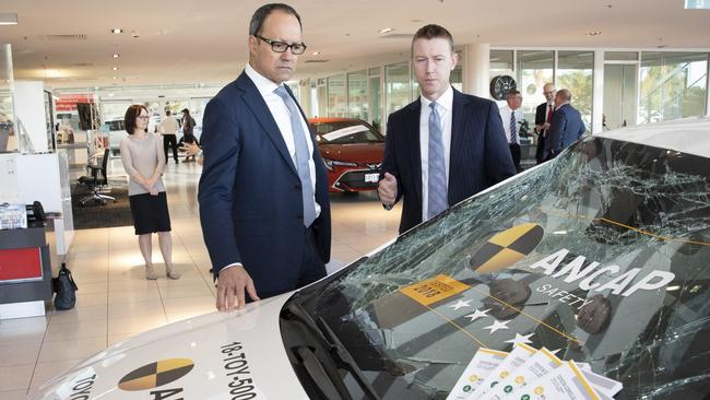 Police Minister Corey Wingard and ANCAP chief executive James Goodwin inspect a safety-tested Toyota Corolla. Picture: Miles Kemp