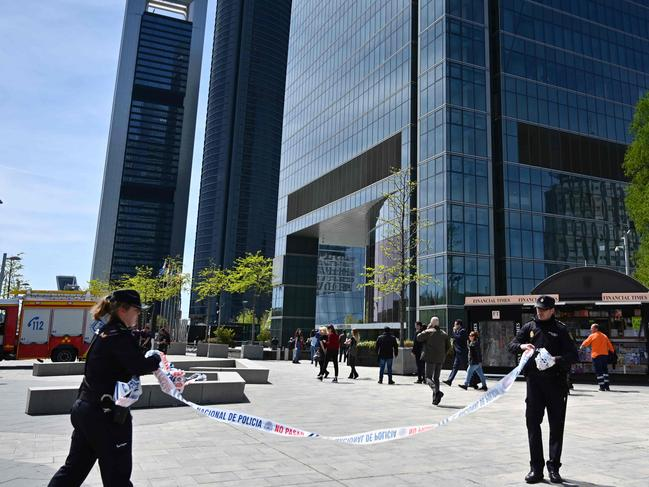 Spanish police remove a cordon outside the Torre Espacio skyscraper after it was evacuated following a bomb threat. Picture: AFP