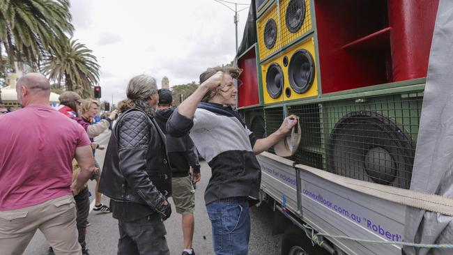 A Right-wing youth punches a set of speakers belonging to the Left. Picture: Wayne Taylor
