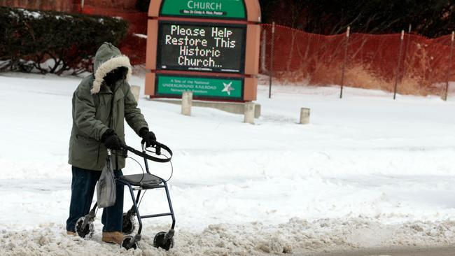 A person with a walker goes over snow in Detroit, Michigan. Picture: AFP