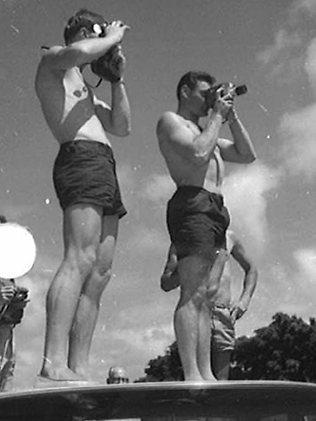Ron Barassi takes some happy snaps in Hawaii.