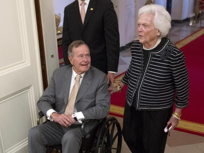Fallen ill ... former US President George H.W. Bush visits the White House in 2012 with his wife Barbara,