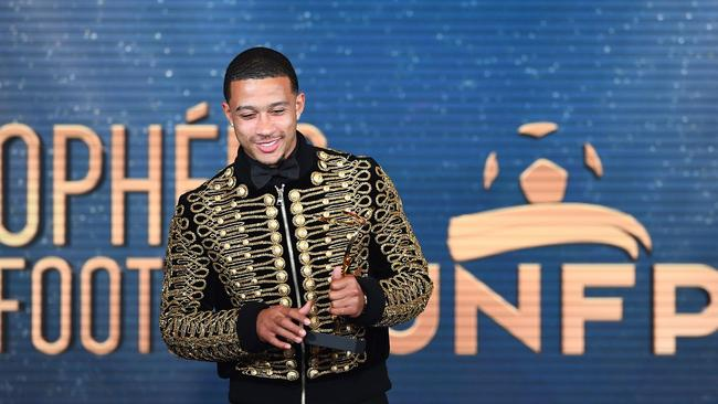 Depay reacts after receiving the award of the Goal of the Year.