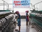 Women work in Kim Jong Suk Silk Factory beneath a banner reading 'Lets Advance with Full-Scale Offensive' on August 21, 2018 in Pyongyang, North Korea. Picture: Carl Court/Getty Images