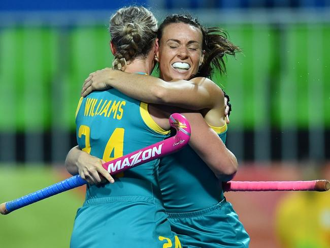 Mariah Williams (L) celebrates with Georgie Parker. / AFP PHOTO / MANAN VATSYAYANA