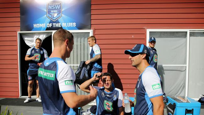Coach Laurie Daley talks to his players and staff.