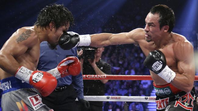 Juan Manuel Marquez lands a right-hand punch to the head of Manny Pacquiao.