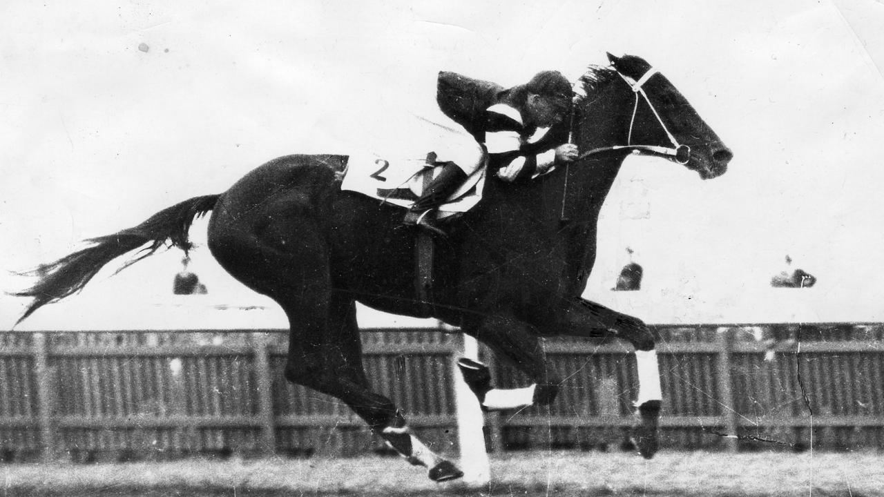 Phar Lap ridden by jockey Billy Elliott winning the Elder Stakes race at Morphettville in May, 1930.