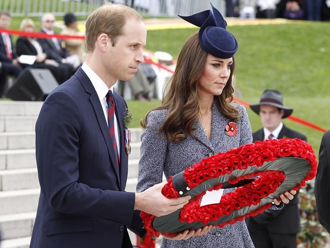Laying a wreath ... William, Duke of Cambridge, and Catherine, Duchess of Cambridge, at the Stone of Remembrance in front of the Australian War Memorial in Canberra.