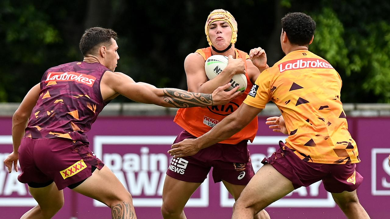 Reece Walsh takes on the defence during a Broncos training session