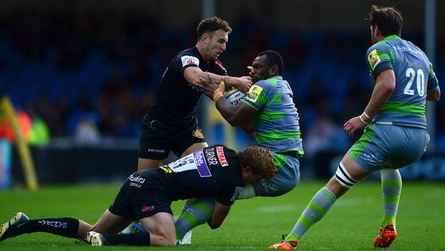 Australians Lachie Turner and Nic White tackle Newcastle's Vereniki Goneva.