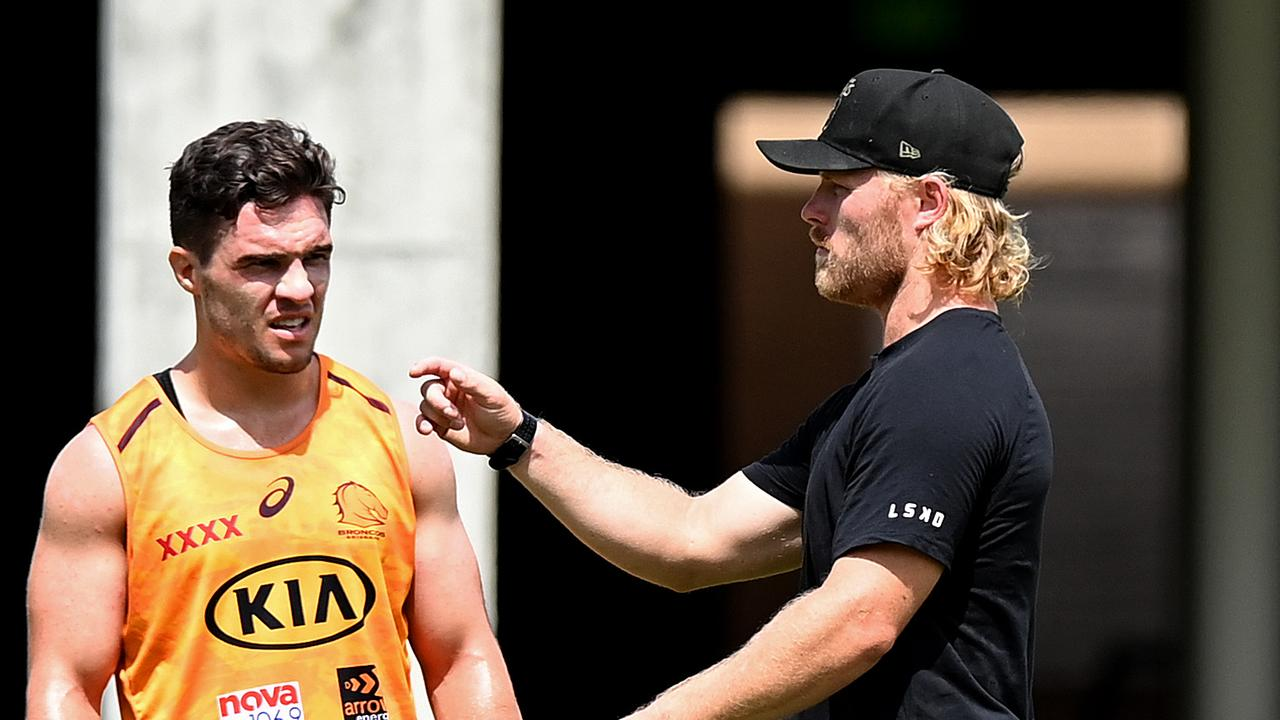 Brisbane Lions AFL player Daniel Rich is seen giving tips to Brodie Croft