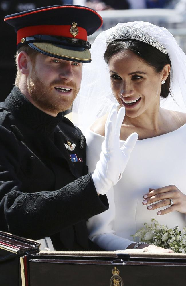 Britain's Prince Harry and Meghan Markle ride in an open-topped carriage after their wedding ceremony at St. George's Chapel in Windsor Castle in Windsor, near London, England. Picture: Aaron Chown/AP.