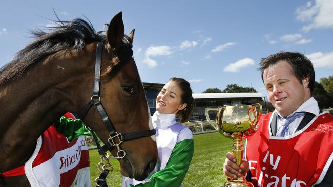Michelle Payne with brother Stevie holding the 2015 Emirates Melbourne Cup. Picture: David Caird