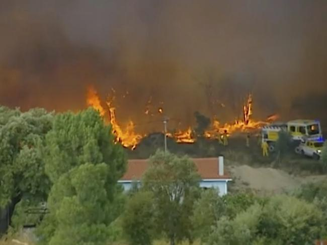 Villages are on fire for the second time in two years as horrific blazes engulf central Portugal and 1,000 firefighters are working to contain fires. Picture: TVI via AP