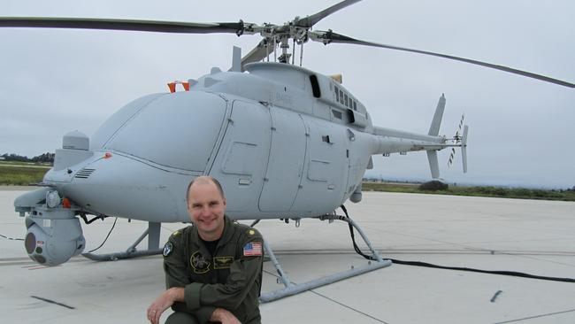 US Navy Fire Scout unmanned helicopter test flight director Lieutenant Commander David Selew with an MQ-8C machine about to undertake a test flight at the Point Mugu Naval Air Station. Picture: Ian McPhedran
