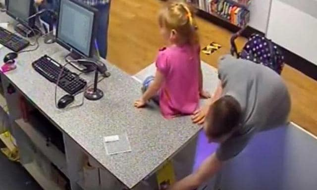 CCTV shows dad using daughter as distraction to steal from shop