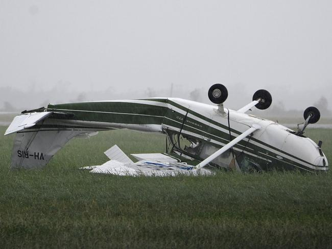 A plane flipped at Bowen Airport during the cyclone. Picture: AAP Image/Sarah Motherwell