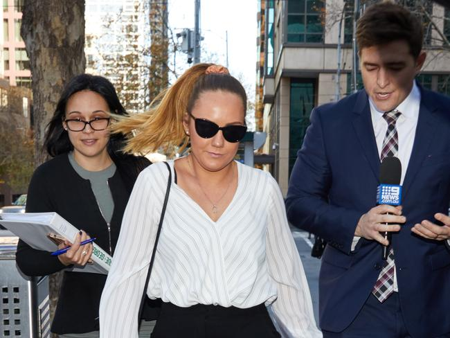 Georgia Gibson leaves the Melbourne Magistrates Court in Melbourne.