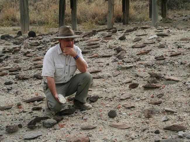 Richard Potts with artefacts in the Olorgesailie Basin in southern Kenya. Stone tools and other items from ancient sites in Kenya give a glimpse at the emergence of some key human behaviours, perhaps including a building of relationships with long-distance neighbours. Picture: Jason Nichols