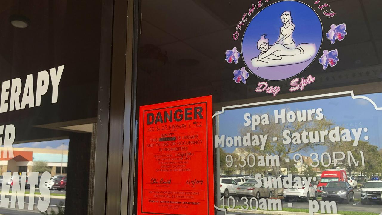 A sign is posted outside of Orchids of Asia Day Spa, Friday, Feb. 19 ,2019, in Jupiter, Fla.