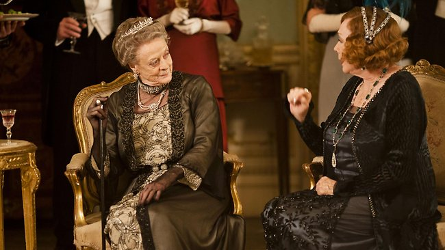 Maggie Smith (L) won the Golden Globe for Supporting Actress, TV Series, Miniseries or Movie for her role in Downton Abbey.