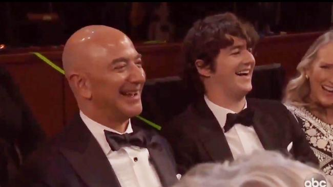 Jeff Bezos appeared to enjoy the jokes.
