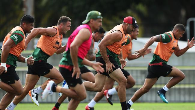 Greg Inglis running with his teammates.