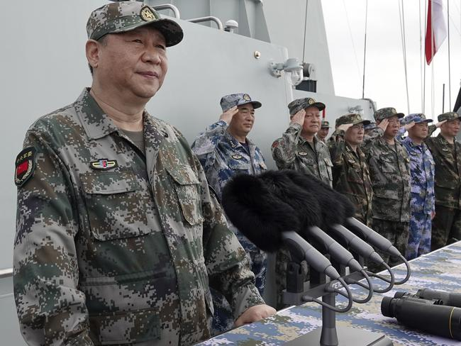 Chinese President Xi Jinping speaks after he reviewed the Chinese People's Liberation Army (PLA) Navy fleet in the South China Sea this month: Picture: AP