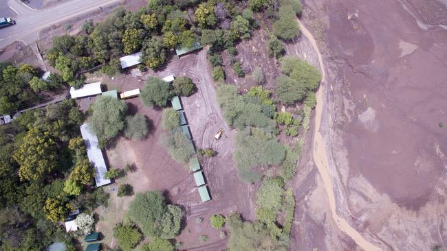 A drone picture shows the extent of the mud the next day.