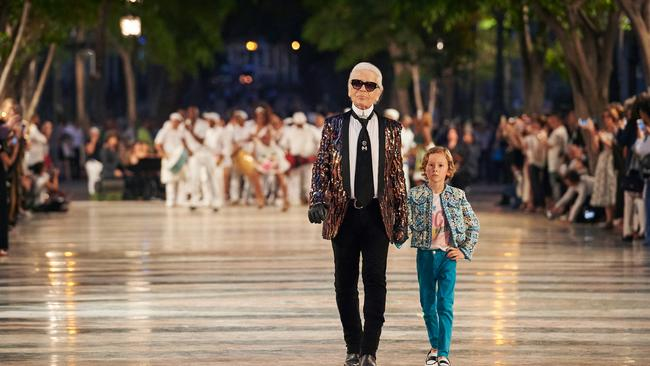 The man: Chanel designer Karl Lagerfeld. And a very cool kid model. Picture: Chanel