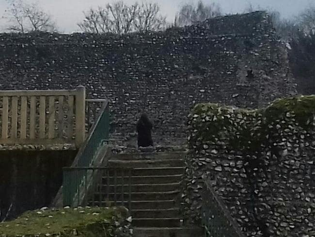 The ghostly figure can be seen at the top of the stairs in Jon Wickes' photo. Picture: Caters News Agency