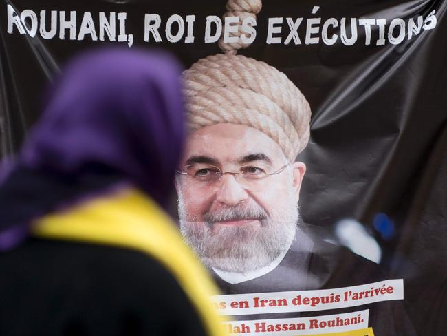 People protest against Iranian President Hassan Rohani during a demonstration denouncing Iran's use of the death penalty in Vienna in March this year.